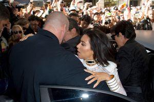 Kim Kardashian gets tackled outside the Balmain Fashion Show **USA ONLY**