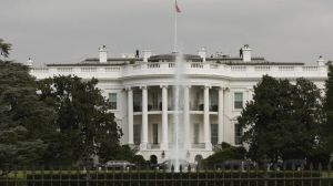 chi-white-house-fence-jump-dogs-20141022-001