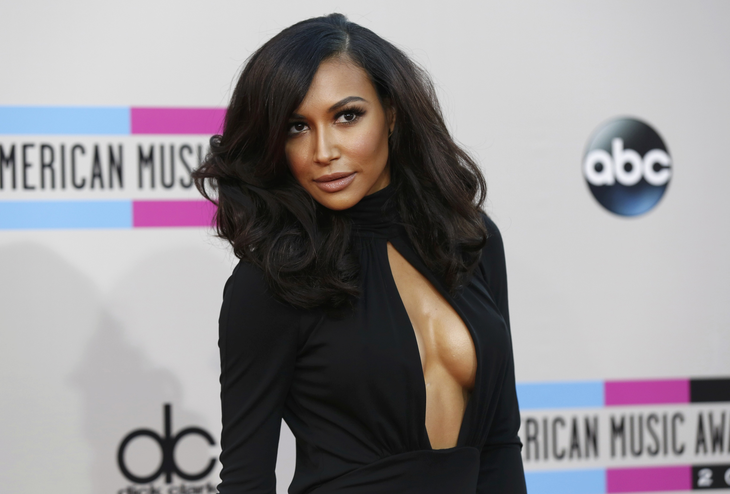 Actress Naya Rivera poses as she arrives at the 41st American Music Awards in Los Angeles