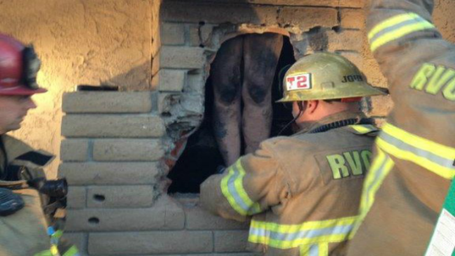 Firefighters rescue naked woman trapped in chimney of ex