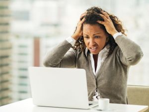 Disappointed African American businesswoman having problems with