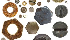 ironmongery - collection of the various nuts rivets bolthead on white background