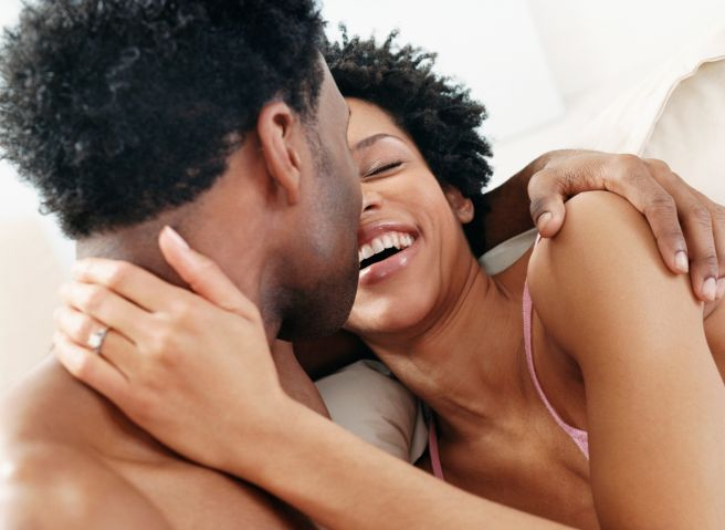 Adoring Couple Embracing in Bed