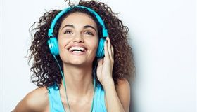 Germany, Hamburg, Young Woman listens to Music