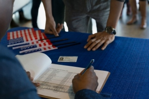 Volunteer checking voters in at polling place