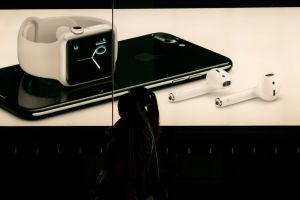 A lightbox shows the new iPhone 7 and wireless earbud in an...