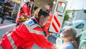 Female Paramedic Helping Injured Women