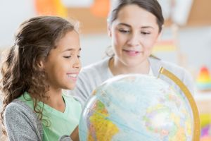 Curious elementary student learns geography