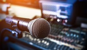 Microphone over the Abstract blurred on sound mixer out of focus background