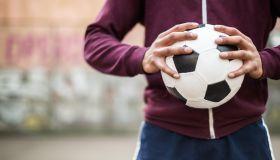 Soccer Player Holding Vintage Soccer Ball