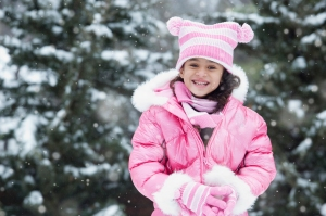 Girl playing in snow outdoors