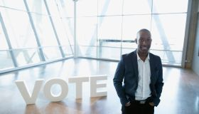 Portrait smiling young businessman near Vote text