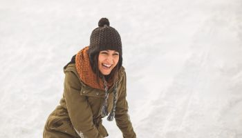 Young woman laughing on snow