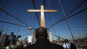 Way Of The Cross Procession Crosses Over New York's Brooklyn Bridge