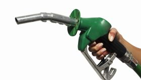 close up view of a hand holding a nozzle for fuel
