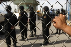 A relative of an inmate observes policem