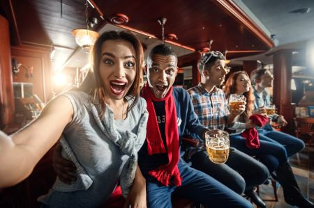 Fans at the bar make selfie on the bar