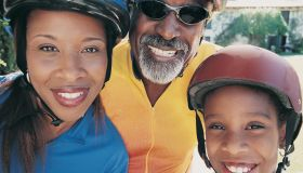 Portrait of Three Members of the Same Family Wearing Cycling Helmets and Jerseys