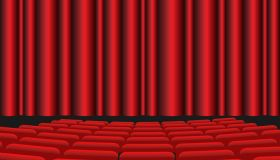 Movie theater with red seats and red curtain