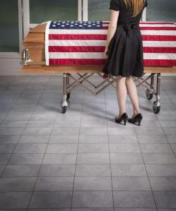 Paying Respects To The Deceased With An American Flag Draped Over The Coffin