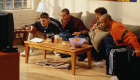 Four Men Watching a Football Game on Television