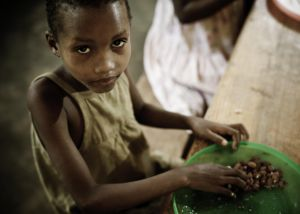African Girl Eating a Meal in the Orphanage