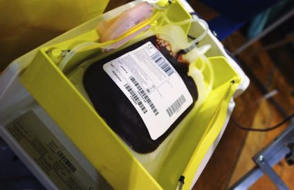 Storage bag being filled with just donated blood