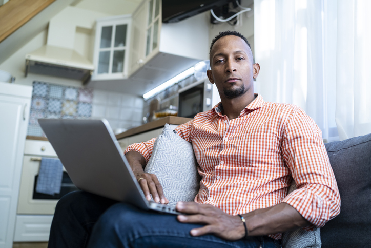 Young african man at home