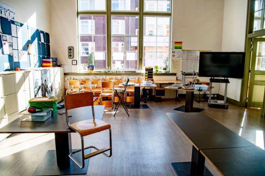 Teacher Lotte's classroom. Teacher Lotte sets up her...