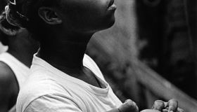 Brazil, Sao Paulo, Paraisopolis. A young mother holds her baby by her home in the favela Jardim Jaqueline in Sao Paulo, Brazil.