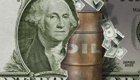 Oil barrel and dollar bill