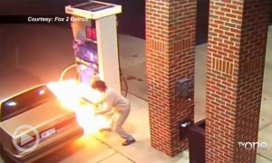WTH?! Thursday: Man Attempts To Kill A Spider With A Lighter While Pumping Gas At A Gas Station