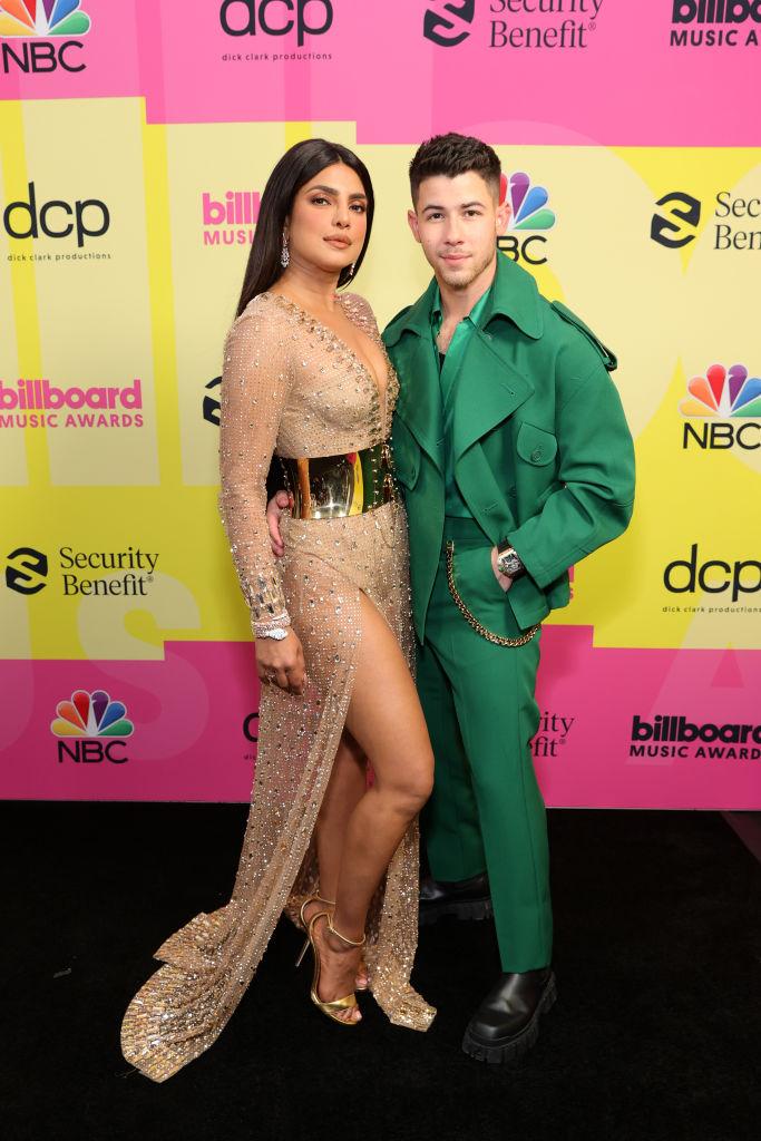 Priyanka Chopra in Dolce and Gabbana and Nick Jonas in Fendi